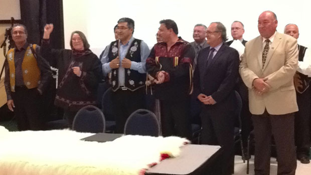 The group of aboriginal leaders and federal and territorial leaders shortly before signing the deal in Inuvik, N.W.T., on Tuesday evening. (Desmond Loreen / CBC)