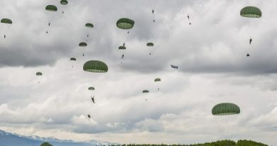 Soldiers from the Army's 4th Brigade, 25th Infantry Division participate in operation Spartan Reach at JBER's Malemute Drop Zone on June 4, 2013. The operation is designed to simulate parachuting behind enemy lines and securing a hostile airfield. (Loren Holmes, Alaska Dispatch)