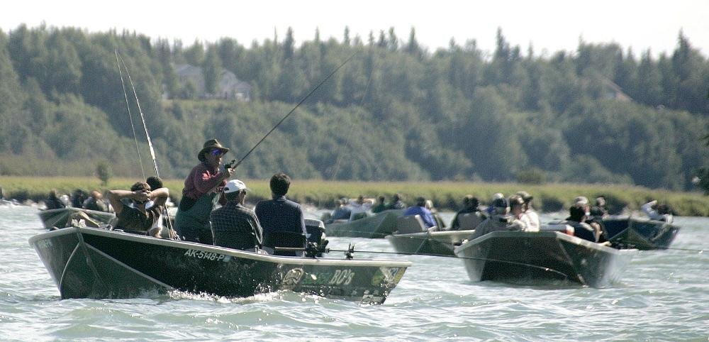 Fishermen crowd together as they jostle for position on the Kenai River in Kenai, Alaska in this 2005 file photo. (Al Grillo / AP Photo)