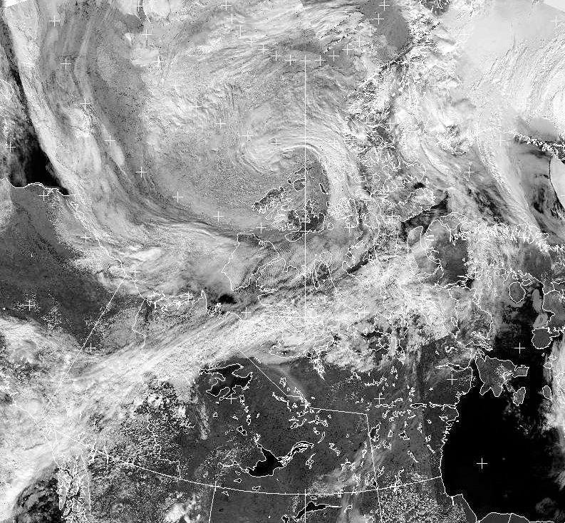 A cyclone (top centre) forms over the Canadian Arctic in an Environment Canada NOAA satellite imagery taken at 15:42 Eastern time on Thursday July 25, 2013. (The Canadian Press)