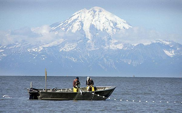 Two fishermen in Cook Inlet off Clam Gulch, Alaska. (File / Al Grillo / AP)