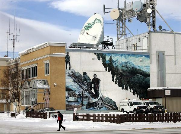 A man walks past Norwestel office in Whitehorse, Yukon. (Chuck Stoody / The Canadian Press)