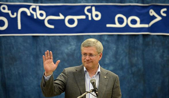 Prime Minister Stephen Harper delivers remarks at a community feast in Rankin Inlet, Nunavut on Wednesday, August 21, 2013. (Sean Kilpatrick / The Canadian Press)
