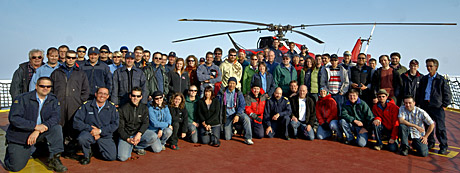 The crew of the Amundsen pose with the helicopter that crashed on Monday, in this undated photo. The crew aboard the icebreaker usually consists of 40 scientists and 40 ship crew, who operate as a tightly knit group. (ArcticNet)