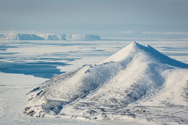 The radar station Tin City, in the foreground, looks across the Bering Stait to the Diomede islands, and beyond them, Chukota, Russia. This is the narrowest point of the Bering Strait, and an increasingly important shipping corridor. (Loren Holmes / Alaska Dispatch)