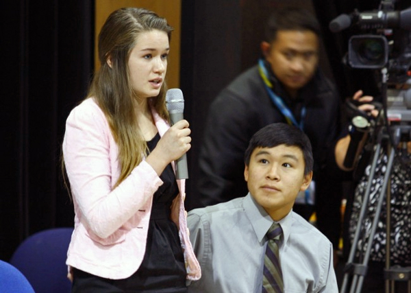 Katherine Dolma answers a question following a Supreme Court LIVE hearing at Barrow High School. Dolma and Nelson Kanuk, seated, are two of the six young plaintiffs in the case. (Jeff Seifert, KBRW – Barrow)