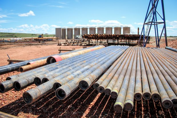 A glut of oil in the Lower 48 has analysts increasingly predicting that oil prices could drop in the months to come. But if it lasted long, such a decline would be problematic for Alaska, where the government budget largely depends on oil production and where one third of all jobs depend on money generated in its oil patch. Pictured are pipes at an oil drillsite in Williston, North Dakota, 2011. Lindsey Gira / cc via flickr