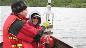 Collecting sediment cores in the Hudson Bay Lowlands using a Glew gravity corer. Dr. Andrew Paterson (foreground) and Chris Jones in back. Core samples give historical record of biology in the region and thus climate changes. Samples revealed significant changes in the past 15 years as a result of warming. ( Bill Keller)