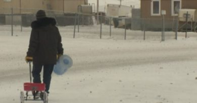 Simon Okpakok makes this walk twice daily to get water for his family's home. (CBC)
