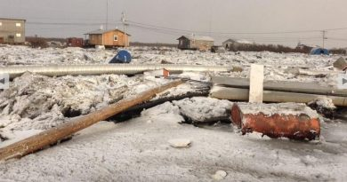 Ice buildup from flooding in the community of Kotlik. Nov. 11, 2013. (Patricia Okitkun / courtesy Alaska Dispatch)
