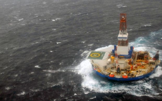 The drill rig Kulluk in rough seas off Kodiak Island, where it eventually went aground. Now Shell says that repairs may be too costly to justify the return of the Kulluk to drilling. USCG photo