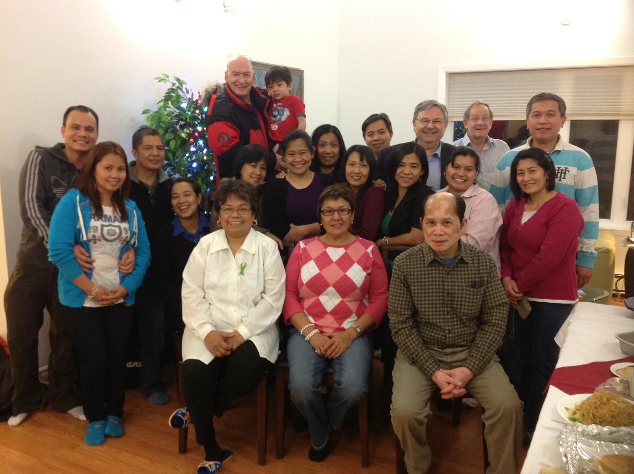 Filipino Christmas Party in Iqaluit. Front row (L-R): Judy Grace Gabuna, Commissioner Edna Elias, and Bob Gabuna. December 2012. (Bob Gabuna)