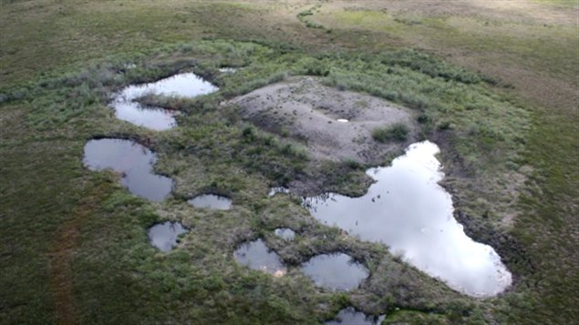 Leaching is coming from waste piles called sumps, which were frozen into the permafrost during oil and gas exploration work. (Queen's University)