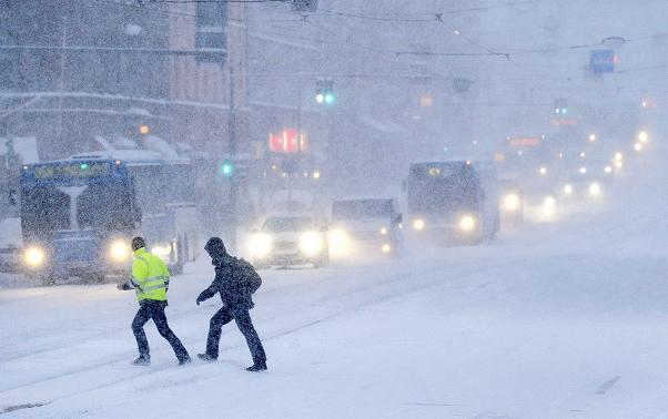 A snow covered road in Helsinki, Finland in 2012. How will the changing climate affect the country? (AFP)