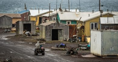 A boy rides a four-wheeler through the rural Alaska community of Savoonga on Saint Lawrence Island in the Bering Sea. (Loren Holmes / Alaska Dispatch)