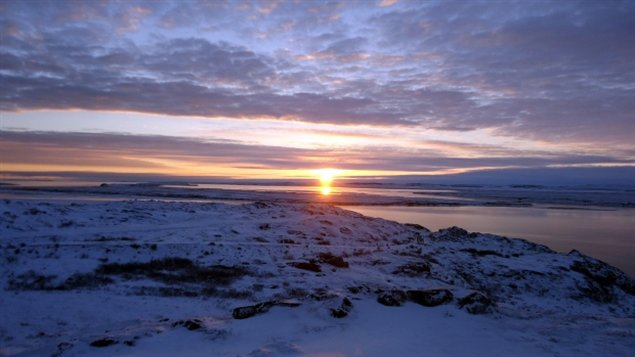 Sunrise in Kugluktuk, Nunavut. The hamlet's emergency siren now sounds at 8:30 a.m. every school day to get the kids out of bed and into class. (Peter Kakolak)