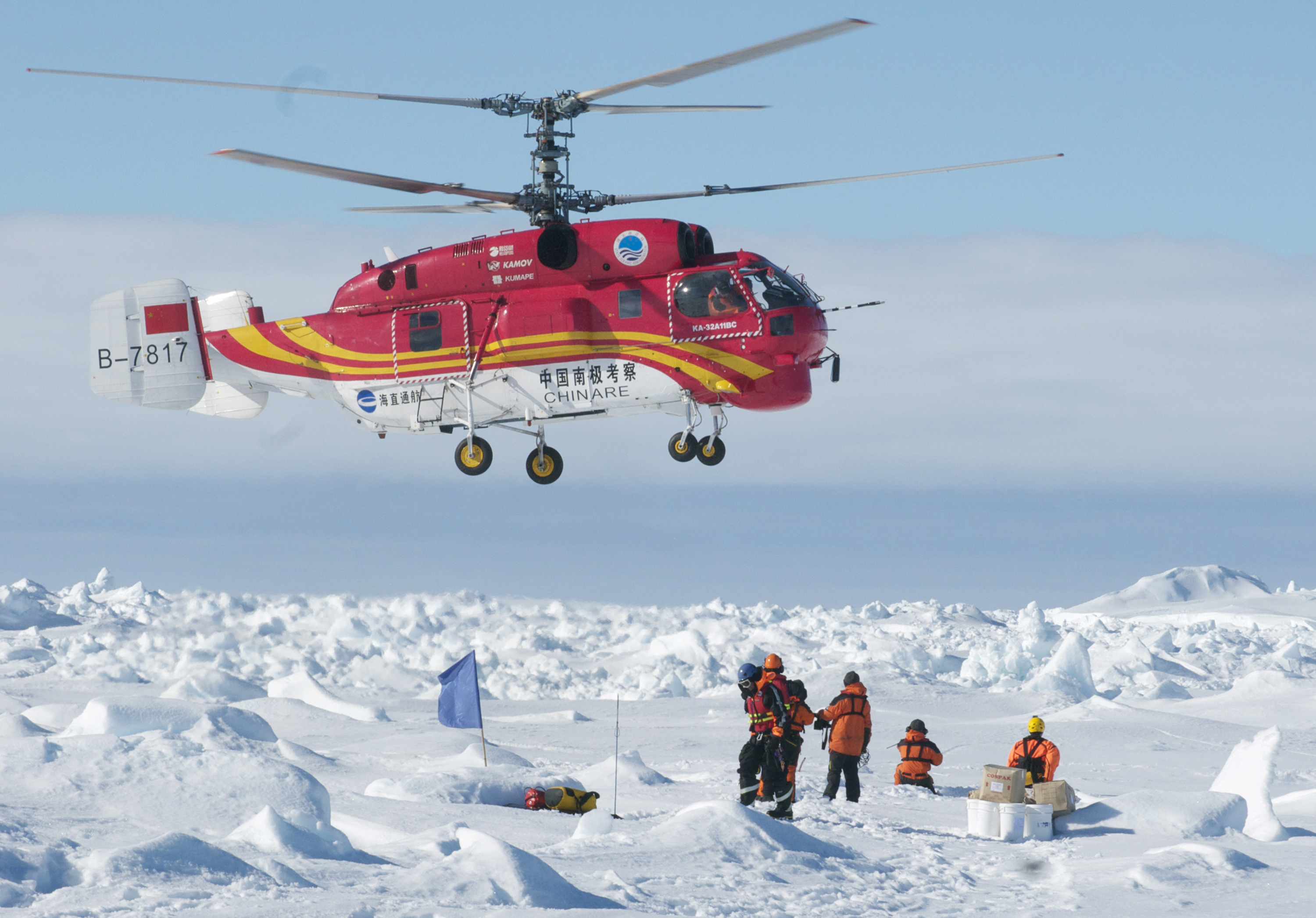Rescue helicopter from the Chinese ship Xue Long in Antarctica. The helicopter ferried the scientists, tourists and journalists in groups of 12 to an Australian government supply ship, the Aurora Australis.  (Jessica Fitzpatrick / Australian Antarctic Division / AFP)