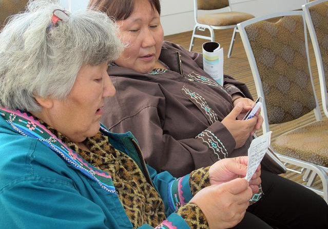 "Two Alaska women in Barrow, Alaska singing ""I'm Dreaming of My Home"" in Inupiaq. (Mark Thiessen / AP)"