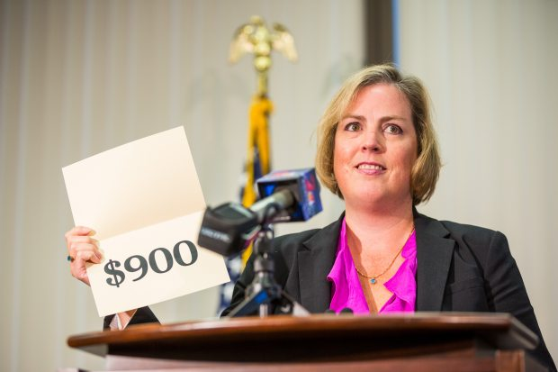 Alaska Revenue Commissioner Angela Rodell, shown here announcing the 2013 Permanent Fund Dividend amount, said her department didn't attempt to make oil production forecasts beyond 10 years out and thus couldn't say whether production would begin increase that far in the future. (Loren Holmes / Alaska Dispatch)