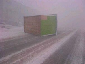 A shed from outside the Ivavik apartment building near the Quickstop slides down Iqaluit's Apex Road. The City of Iqaluit endured wind gusts up to 141 km/h yesterday. (Nauyavik Dennis )