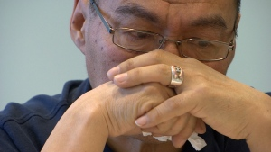 Joanasie Akumalik lost his son, Aapi, one of twins, in October. 'Talk to your parents,' is his message to other young people. 'We cannot hear what you're thinking.' (Vincent Desrosiers/CBC)