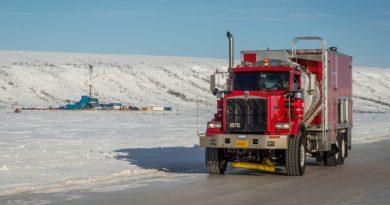 A Cruz Construction mechanics' truck leaves an exploration rig in Umiat, Alaska, via an ice road on March 8, 2013. (Courtesy Stephen Nowers / Cruz Construction / Alaska Dispatch)
