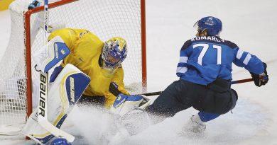 Finland forward Leo Komarov skates into Sweden goaltender Henrik Lundqvist during the third period of the men's semifinal ice hockey game at the 2014 Winter Olympics, Friday, Feb. 21, 2014, in Sochi, Russia. (Matt Slocum/AP)