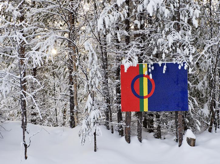 The Sami flag is pictured on snow covered trees at the Kallak prospecting area near Randijaur village, 40 kilometers north-west of Jokkmokk, in Swedish Lapland on November 6, 2013. (Jonathan Nackstrand / AFP)