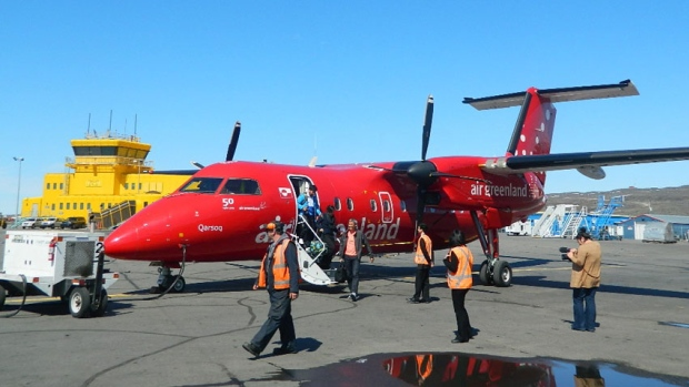 Passengers exit an Air Greenland Dash 8 after arrival at the Iqaluit airport from Nuuk in 2012. The summer flights between the two cities resume this year on June 13. (CBC.ca)