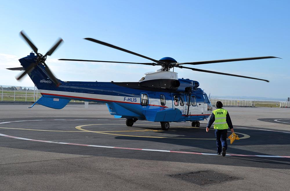A man walks to an Eurocopter's EC225 helicopter. ( Gerard Julien / AFP)
