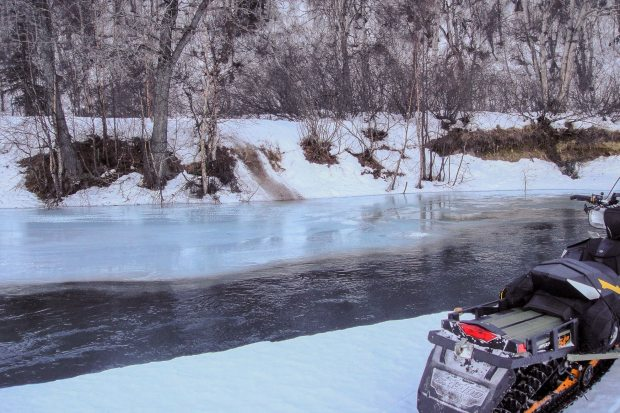The Happy River portion of the Iditarod Trail was open in early February. The trail is visible on the far side of the bank, a dirty path up the bank. (Courtesy Howard Sevey / Alaska Dispatch)