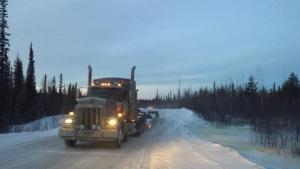 A large truck drives the Sahtu winter road. (Joanne Stassen/CBC)