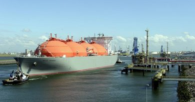 "The LNG carrier, ""Arctic Voyager"" is towed in the port of Rotterdam, The Netherlands on July 6, 2011. The tank ship is designed for transporting liquefied natural gas. (AFP)"