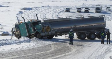 One of the two trucks carrying a mix of water, chemicals and sand used at ConocoPhillips' N.W.T. fracking project that slid off the Sahtu winter road over the past week. (courtesy of Roger Odgaard/Facebook/CBC.ca)