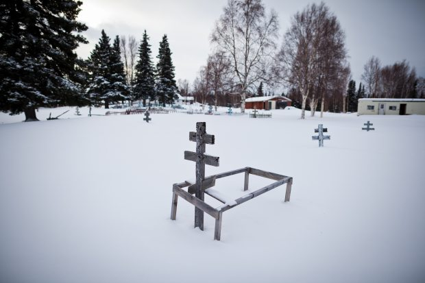 A gravesite outside the St. Nicholas Orthodox Church in Nikolai. (Loren Holmes / Alaska Dispatch)