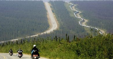A group of motorcyclists drive up the Dalton Highway near the Arctic Circle in Alaska, Aug. 10, 2005. The highway stretches more than 400 miles to Deadhorse, a Prudhoe Bay industrial camp just south of the Arctic Ocean. (Al Grillo/AP)