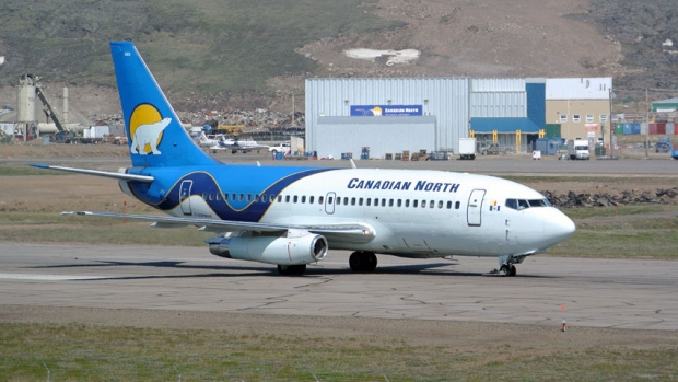 A Canadian North 737 taxis at the Iqaluit airport. The owners of Canadian North and First Air have confirmed they are planning to merge the two northern airlines. (CBC)