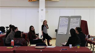 UBC researcher Karina Czyzewski and local women discuss social implications of the presence of the mine in their community. (Courtesy F. Tester)
