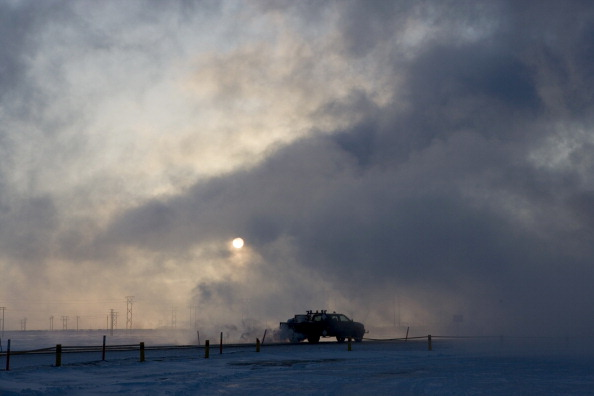 A truck moves along a road near BP's North Slope facilities at Prudhoe Bay, Alaska in 2007.  (Photo by Bob Fila/Chicago Tribune/MCT via Getty Images)