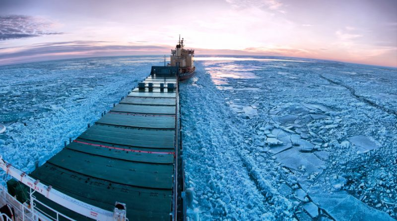 Icebreaker towing cargo ship through thick ice-field in the European Arctic. What kind of shipping traffic will the North American Arctic experience with the changing climate? (iStock)