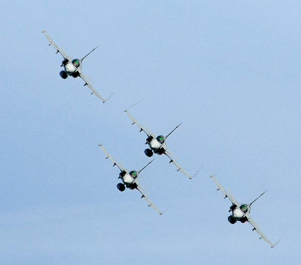 Pilots flying four JAS 39 Gripen jet fighters perform during the Day of the Airforce in Linkoping, Sweden on June 13, 2010. (AFP)