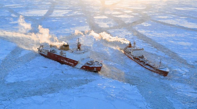 The Coast Guard Cutter Healy approaches the Russian-flagged tanker Renda while breaking ice around the vessel 97 miles south of Nome, Alaska on Jan. 10. Photo by Petty Officer 1st Class Sara Francis.