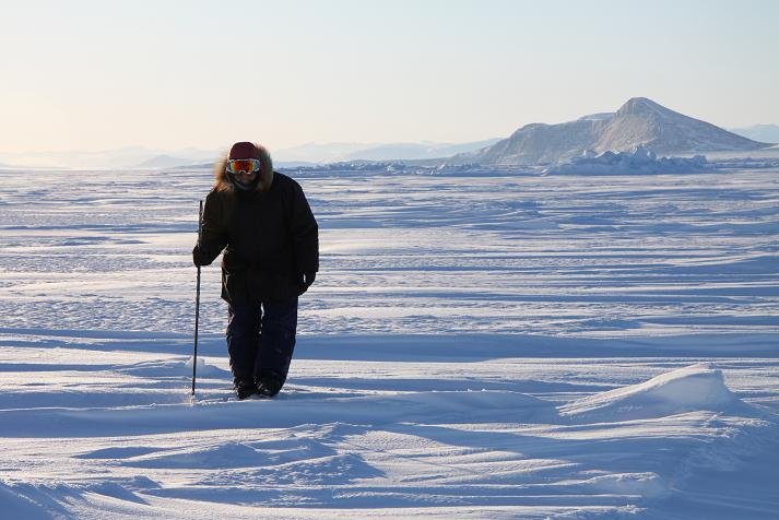 Inuit hunter Elijah Palituk looks for seal breathing holes in the ice off the coast of north-east Baffin Island. Photo by Levon Sevunts.