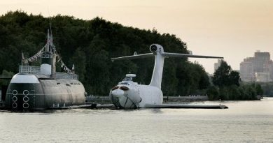 The Soviet built Orlyonok type ekranoplan is anchored near a submarine on Khimkinskoye reservoir. Ekranoplans, also known in the West as Ground effect vehicles or Wing in surface effect ships, fly only a few meters above any flat surface, usually the water surface, saving energy. Photo: Ivan Sekretarev, AP Photo.