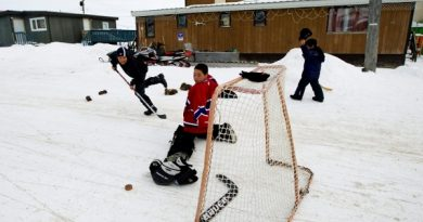 Children play a game of road hockey in Iqaluit in the Nunavut Territory of Canada on Wednesday, April 1, 2009. THE CANADIAN PRESS/Nathan Denette