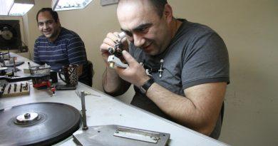 Matevos Harutyunyan of Yellowknife examines a diamond he's been polishing at Melisende Diamonds Ltd. in Montreal as his friend Vardan Sukiasan looks on. Levon Sevunts