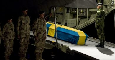Swedish Supreme Commander Sverker Goransson pays respect at the coffin of Swedish soldier, Sgt. Kenneth Wallin, killed by a roadside bomb in Afghanistan. October 19, 2010. AFP