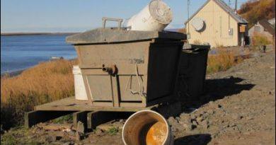 Honey buckets and a sewage bunker in Pitkas Point. Jill Burke photo