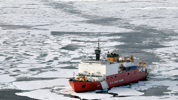 The U.S. Coast Guard Cutter Healy breaks ice ahead of the Canadian Coast Guard Ship Louis S. St-Laurent in the Arctic Ocean in 2009. (Petty Officer Patrick Kelley/U.S. Coast Guard/AP)
