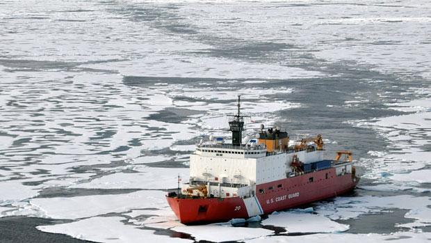 The U.S. Coast Guard Cutter Healy breaks ice ahead of the Canadian Coast Guard Ship Louis S. St-Laurent in the Arctic Ocean in 2009. (Petty Officer Patrick Kelley/U.S. Coast Guard/AP)